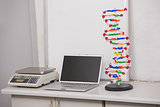 Weighing scale with computer and dna helix on the desk