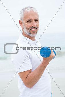Fit man lifting dumbbells