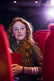 Young woman watching a film