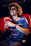 Smiling young man watching a 3d film