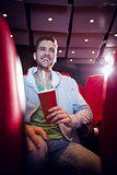 Happy young man watching a film