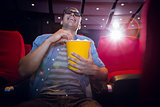 Happy young man watching a 3d film