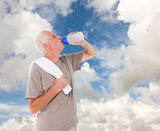 Composite image of senior man drinking from water bottle