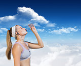 Composite image of sporty blonde drinking water