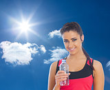 Composite image of fit woman holding water bottle