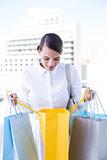 Beautiful brunette holding shopping bags