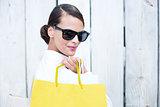 Pretty brunette holding shopping bags