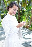 Pretty woman using her smartphone