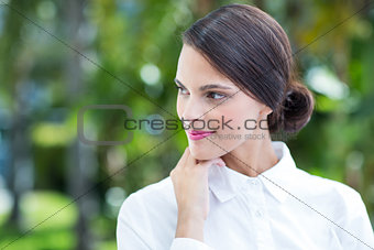 Thoughtful woman with hand on chin