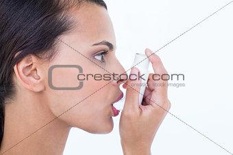 Beautiful using her inhaler