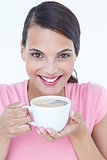 Pretty brunette drinking cup of coffee