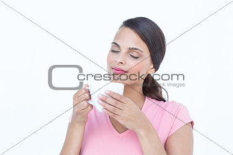 Beautiful woman smelling her coffee