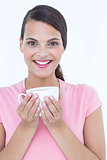Pretty brunette holding coffee cup