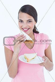 Beautiful woman eating sandwich