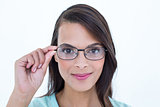 Pretty woman holding her eyeglasses
