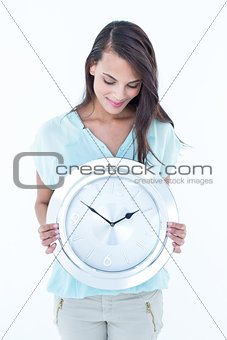 Beautiful woman holding a clock