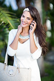 Beautiful brunette on the phone