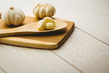 Garlic cloves and bulb on chopping board