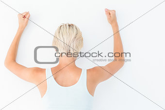 Angry woman hitting the wall