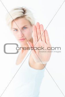Angry pretty blonde showing her hand
