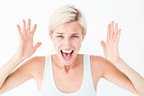 Angry blonde screaming with hands up