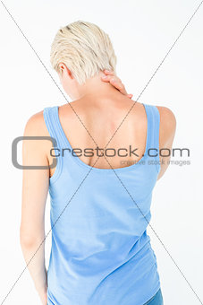Casual woman suffering from neck ache