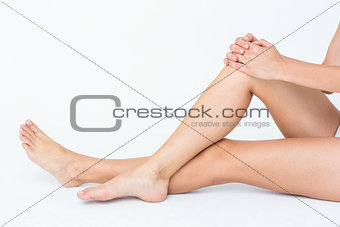 Fit woman sitting on the floor
