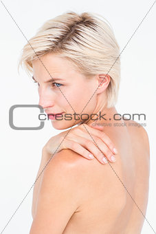 Attractive woman touching her shoulder