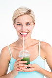 Attractive blonde drinking green juice