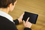 Businesswoman using tablet at desk