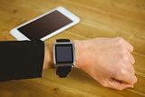 Businesswoman with smart watch on wrist