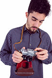 Casual man holding his camera