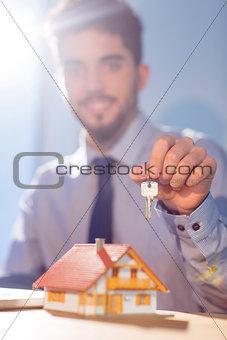 Businessman showing a key