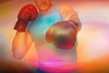 Composite image of close-up of a determined male boxer focused on training