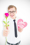 Composite image of geeky hipster holding a red rose and heart card