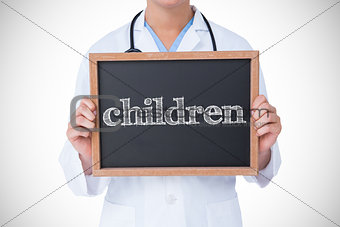 Children against doctor showing little blackboard