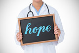 Hope against doctor showing little blackboard