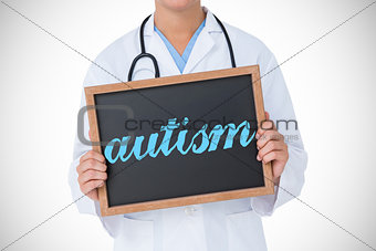 Autism against doctor showing little blackboard