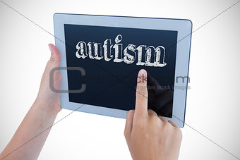 Autism against woman using tablet pc