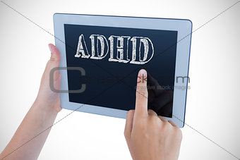 Adhd against woman using tablet pc