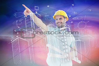 Composite image of male architect with blueprints pointing away