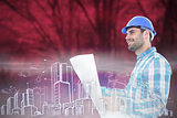 Composite image of smiling engineer looking away while holding blueprint