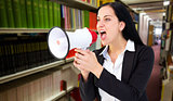 Composite image of pretty businesswoman shouting with megaphone
