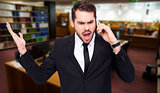 Composite image of angry businessman gesturing on the phone