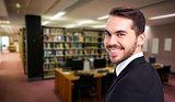 Composite image of elegant businessman in suit smiling at camera