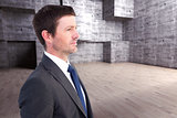 Composite image of handsome businessman looking away
