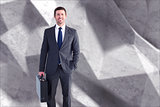 Composite image of businessman standing with his briefcase