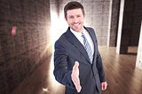 Composite image of businessman smiling and offering his hand