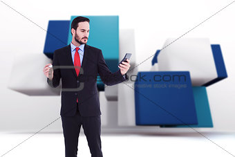 Composite image of handsome businessman texting on phone