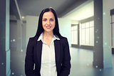 Composite image of pretty businesswoman smiling at camera